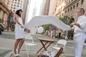 Diners unfold white linen on the Avenue of the Arts to preview Diner En Blanc.