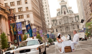 Diners in white feast on a picnic in front of Philadelphia City Hall to preview Diner En Blanc.