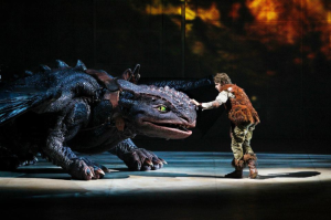 Dragon and Viking on Stage in Dreamworks' How to Train Your Dragon Live Specatular