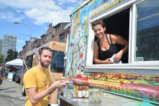 Steph Tarbous gives Dan Novin a delicious dish from The Farm Truck, Clean Air Council's Greenfest Philly, by Hughe Dillon.jpg